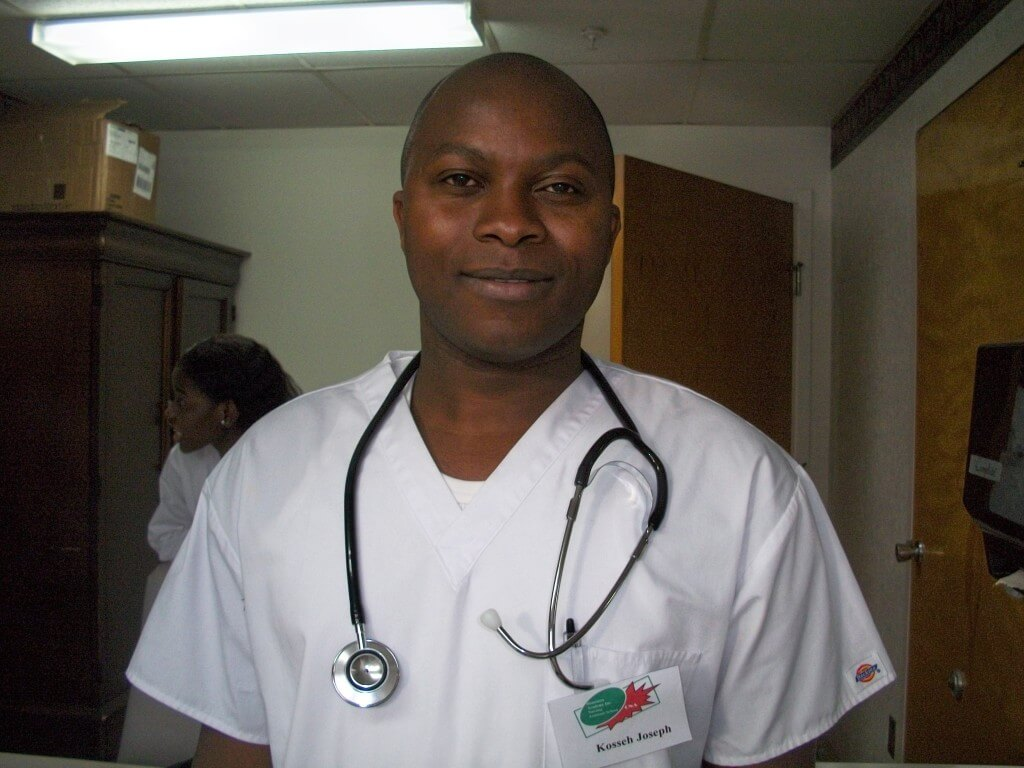 male nurse standing with a smile