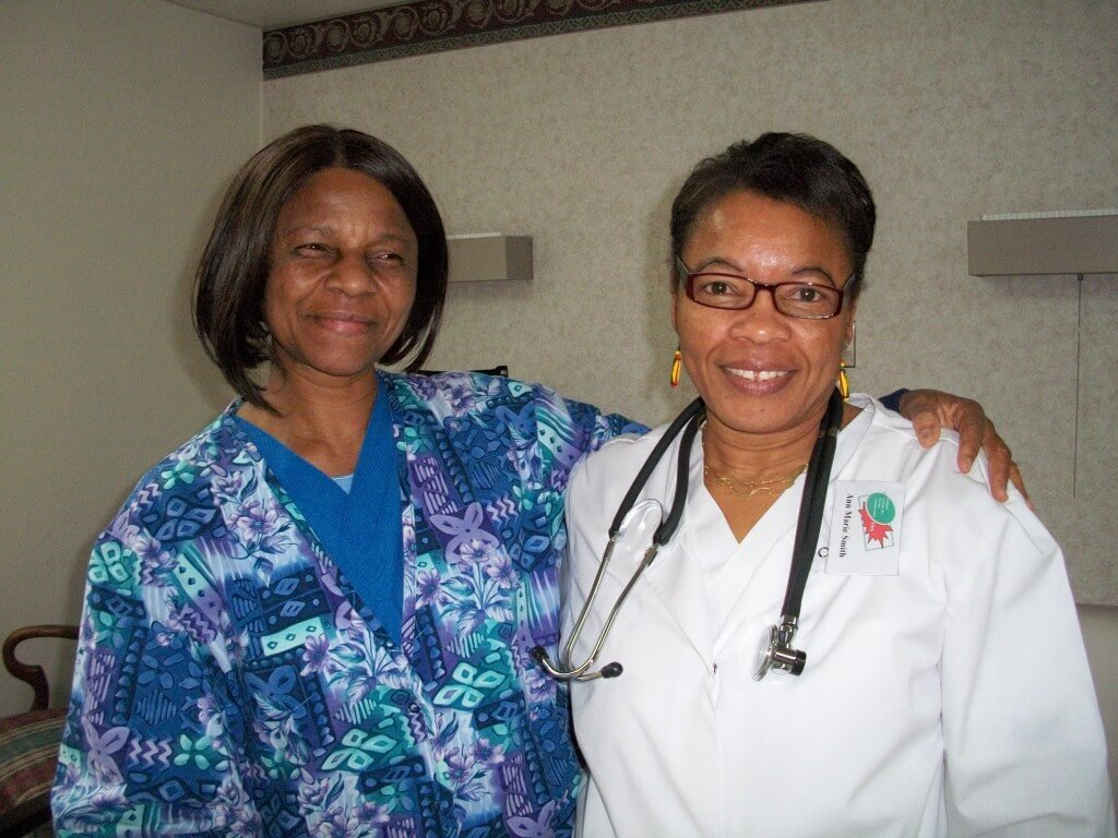 two women nurses smiling